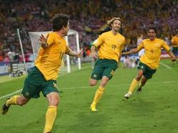 Australia's Harry Kewell celebrating a goal with the rest of his mates.