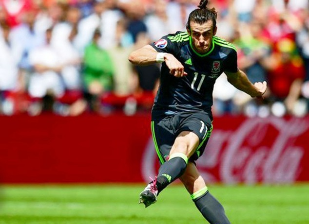 Gareth Bale scores a free-kick for Wales during their Euro 2016 Group B match against England