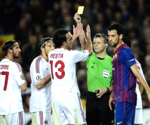 Barcelona, AC Milan and B. Kuipers engaged in a controversial match at the Camp Nou.