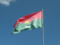 Burkina Faso's national flag raised in the air