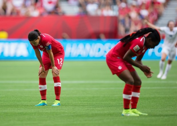 Christine Sinclair and Kadeisha Buchanan dejected following Canada's heartbreaking 2-1 defeat to England at the 2015 FIFA Women's World Cup.