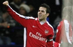 Arsenal captain Cesc Fabregas celebrates as they beat FC Porto 5-0 in the Champions League