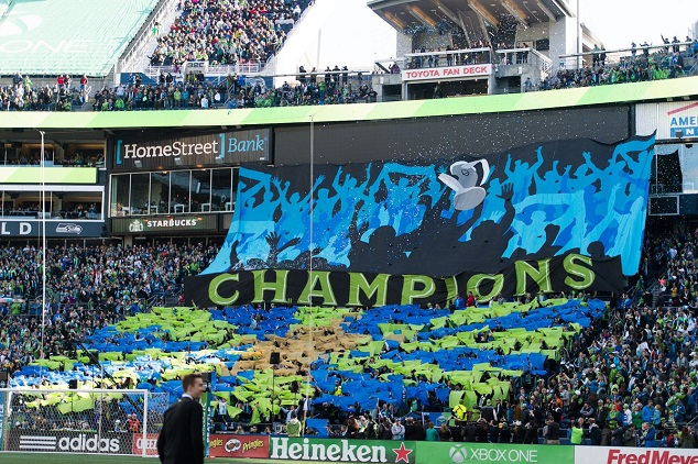 'CHAMPIONS' one giant banner declared