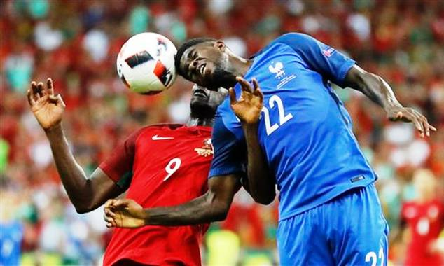 The French central defender fight for the ball with Portugal striker Eder during the finals of the European Championship