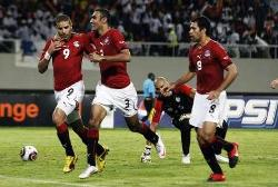 Egypt's players celebrate once again as they widen the gap against Algeria.