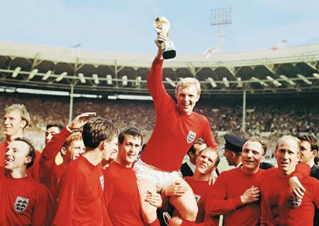England captain Bobby Moore hoists the Jules Rimet trophy follwoing England's win over West Germany in 1966
