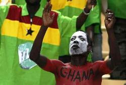Painted Ghana fan concentrates in quest of victory for his side.