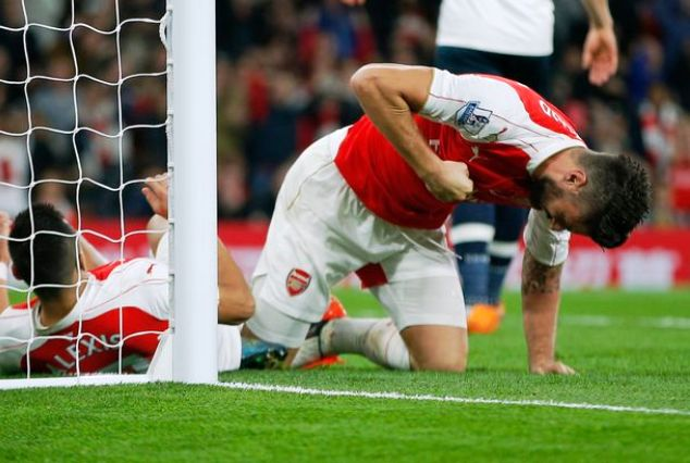 Giroud (right) rues a missed chance in a Premier League match for Arsenal