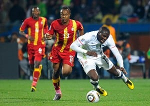 USA's Jozy Altidore fakes a fall as Dede Ayew is behind him.
