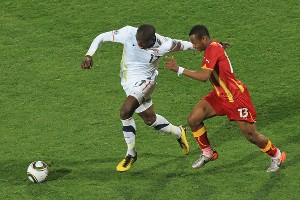 USA's Jozy Altidore escapes from Andre Dede Ayew