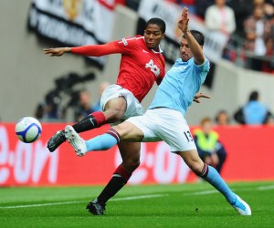 Manchester United and Manchester City play against each other in the 2011 FA Community Shield.