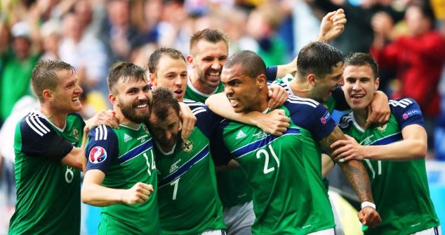 Northern Ireland players celebrate their qualification for the last round of 16 at the European Championship in France