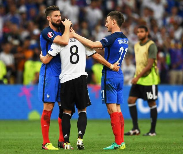 Olivier Giroud (far left) and Laurent Koscielny (right) console Mesut Ozil after Germany lost to France on Thursday in the semi-finals of the Euro 2016