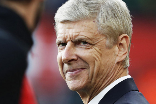Wenger sets record with Brighton win