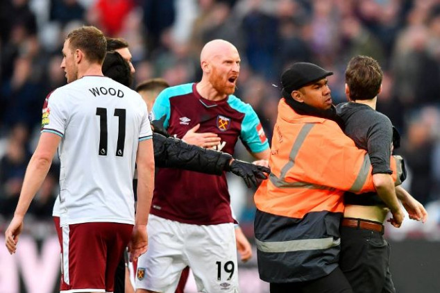 West Ham faces ban over pitch invasion