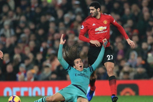 Fellaini escapes booking against Arsenal