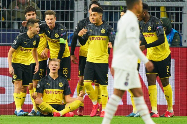 Haaland makes history with Champions League brace